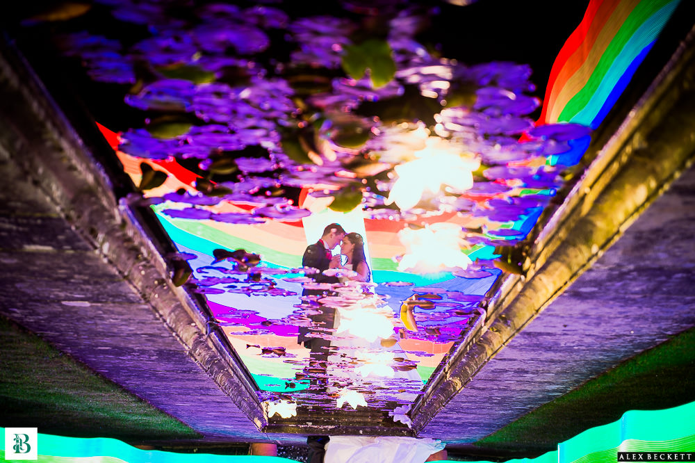 Combining pixelstick with reflections. Pixelstick provides a wealth of colorful accents to the shot while remaining largely in the back seat. Courtesy of top wedding photographer Alex Beckett