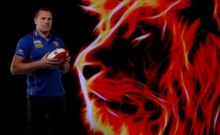 Pro Shooter Peter Wallis shot one pretty hot lion next to Australian Rules Football coach Justin Leppwitsch.