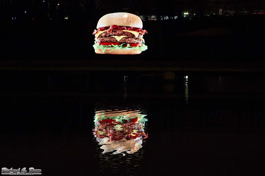 The only thing more appetizing than a six foot levitating cheeseburger is a six foot rippling reflection. Courtesy of Rick Drew Photography.