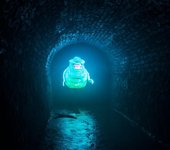 Slimer washes the walls with the eerie green glow of the afterlife.