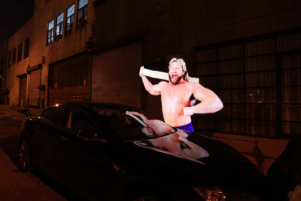 """Hacksaw"" Jim Duggan casts his light upon the hood of a Hyundai Elantra."