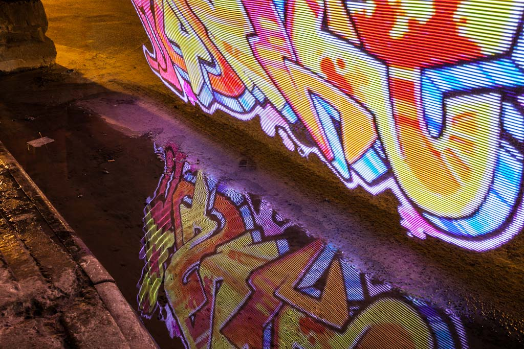 A little bit of graffiti peeking up from a puddle. This was shot with no diffuser in front the LEDs, so each horizontal line looks very discrete.