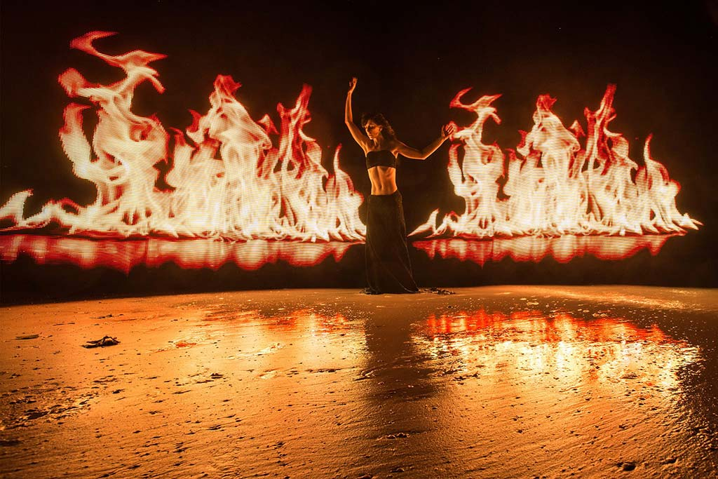 The flame image loaded onto pixelstick not only creates the realistic looking fire, but also casts a ton of lovely orange light over the dancer as well as the reflection on the ground below. Courtest of Eric Pare photography.